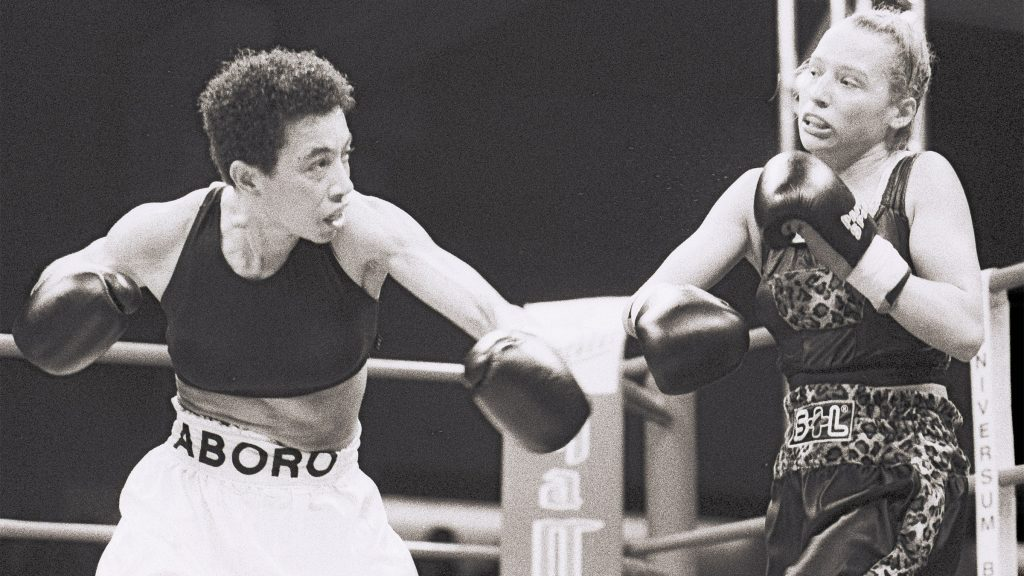 In November 1997, Aboro defeated another future world champion, Daisy Lang, in a sixth-round decision