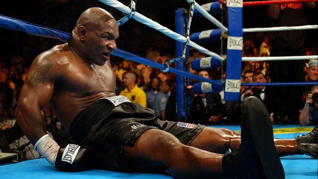 """""""Dunzo"""" The iconic 'Iron' Mike Tyson sits on the canvas at the end of the 6th round in his last professional fight with Kevin McBride. Tyson did not come out for the next round."""