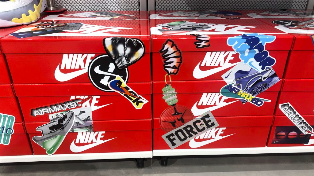 Boxes of Nike shoes adorned in grafitti stickers